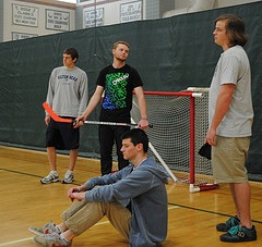 Several High School kids are bored after school, trying to get a pick up game of floor hockey started and wishing intramural sports weren't canceled. Photo By Connor Engstrom
