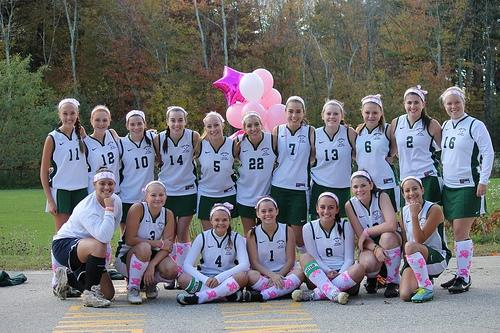 The Hopkinton Varsity field hockey team before their game on October 12th support and raise awareness for breast cancer by donate for 'Play 4 a Cure'. Photo by Samantha Sullivan