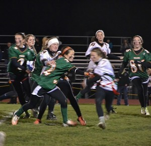 Seniors (in green, left to right) Lauren Ballantyne, Lexie Papadellis, and Erin Sheehan defend against juniors (in white, left to right) Maddie Whittles, Kathy Taggert, Kendall Ericksen, and Lizzi Allen. Photo by Karissa Collins