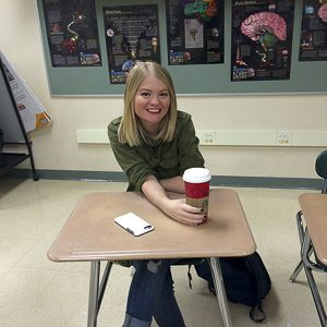 Lucy starts her day off regularly with Starbucks coffee. Photo by Shae Feather