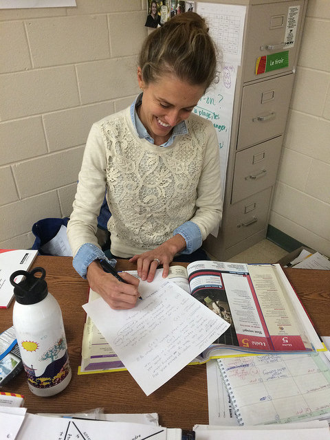 Foreign Language teacher Liza Lyons corrects homework during a prep period. Photo by Juliette Davis.