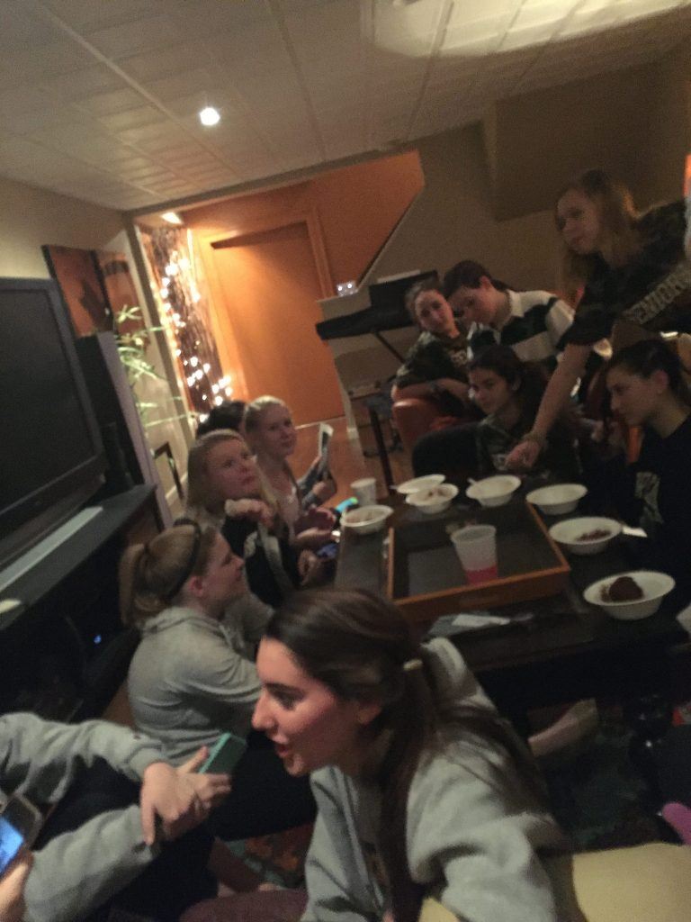 The senior girls get together the night before the game to eat, do their hair, and have fun. Photo by Emma Zack.