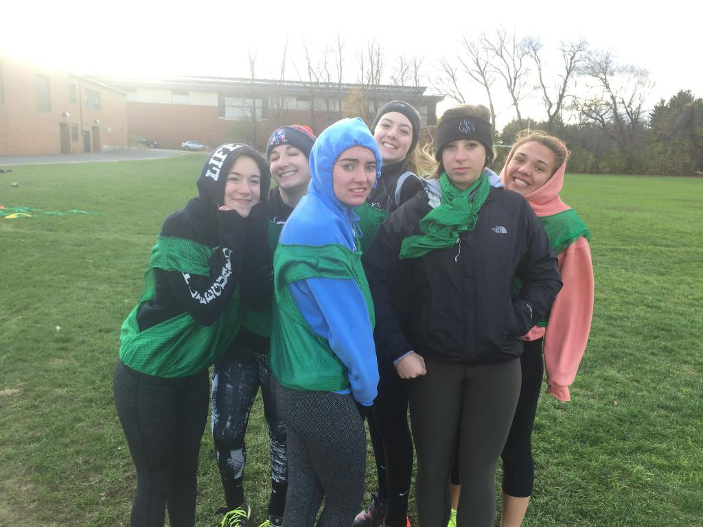 Senior girls practice in the cold and rain for the big game on Friday. Photo by Casey Palmer.