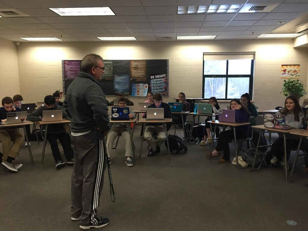 Mr. Hooker teaching one of his ninth grade wellness classes. Photo by: Julia Joshi and Brittany Power