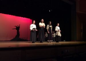 "(From Left) Kyla Atwell, Helen Aghababian, Colleen Malloy, and Elizabeth Barnes performing together in ""Spoon River Anthology"" in the high school auditorium during the Friday show. Photo by Josh Normandeau"