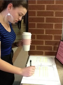 Senior Danielle Hoyt uses senior privileges and signs out of the school during her study. Photo by Sydney Lauro