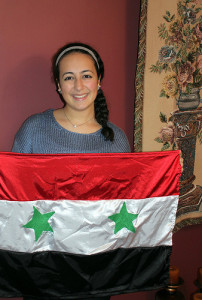 Jasmin Dieb, a senior at HHS, is proud of her Syrian heritage. The country's flag is representative of her and her culture. The black represents the oppression Syria faced, the red represents the blood of those who fought, and the white represents peace and hope for a better future. Photo by Cassandra Boyce