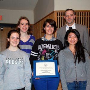 HHS Press staff members, Sarah Cavanaugh, Maria Moreno, Casey Rector, Julia Li, share Suffolk University Award with Principal Bishop.  Photo by Andrew A. Dickason.