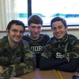 Dan Barra, Tim Greizer, and Brandon Carty represent the Senior Class with their camo