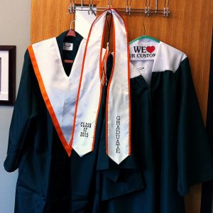 Administration has given the Class of 2015 the opportunity to vote for the type of green graduation gown that they like most. Photo by Ashley Olafsen.