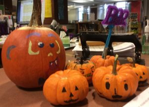 The Hopkinton High School library displayed some of the many decorative pumpkins created at the HHS Book Club movie night to celebrate the authentic holiday. Photo by Sabrina Martin.