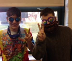 Blake Dobay and Trevor Perkins flash the peace sign on 60s day. Photo by Owen McNamara.