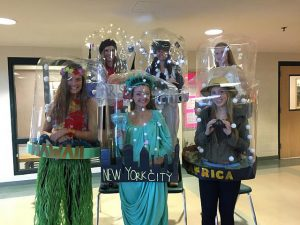 The snow globe group (top row left to right) Anna Bullock, Emily Marculitis, Julia Krapf, (bottom row left to right) Katie Curry, Caroline Coffee, and Rebecca Collins won best DIY costume at HHS senior Halloween. Photo by Veronica Lee.