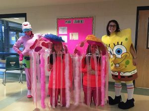 Seniors (from left to right) Emily Schmidt, Bri Mirabile, Azilee Curl, and Maia Guelfi, dress up as characters from Spongebob for senior Halloween. Photo by Veronica Lee.