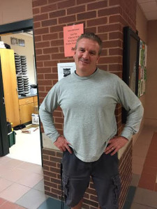 Wellness teacher Michael Hooker standing outside the wellness offices in-between class periods. Photo by Veronica Lee.