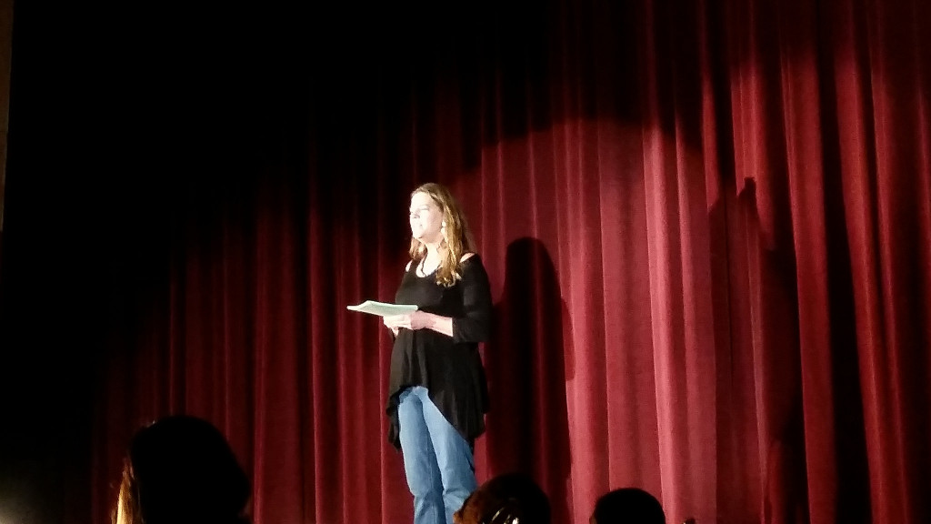 The show's director, Valerie Von Rosenvinge, giving her opening statement prior to the show's start on opening night.
