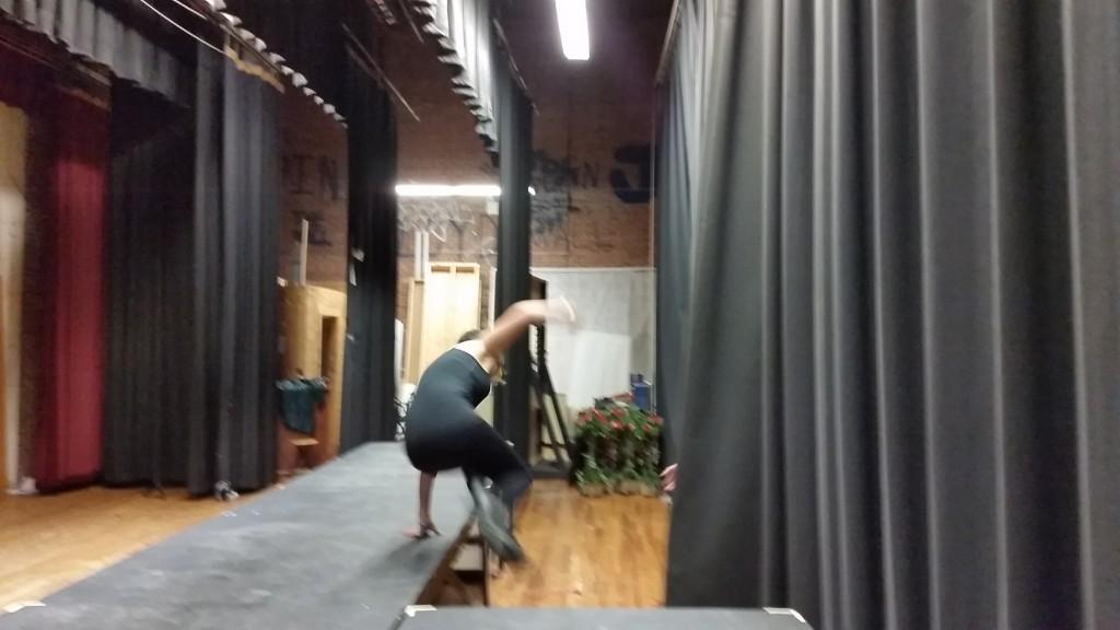 Stage manager McKenzie Simmons jumping from the set following one of the show's quick set changes.