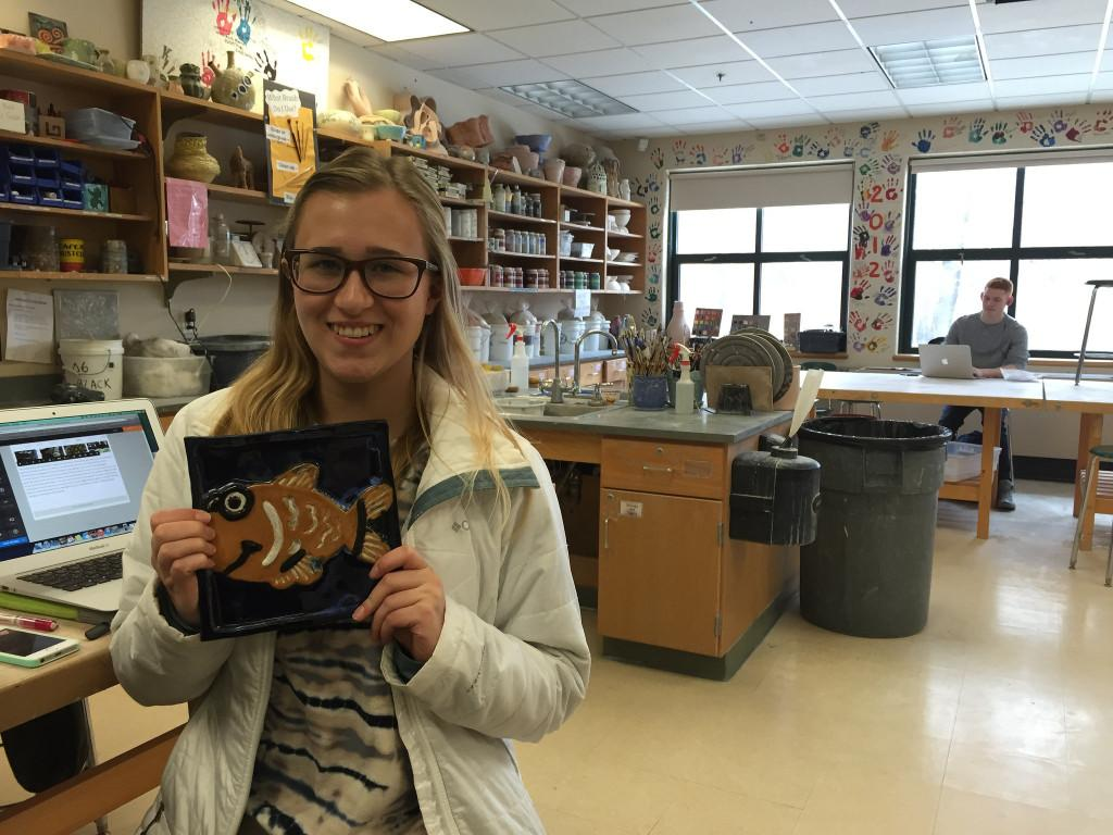 Senior Jill Kellet shows off her latest project. Photo by Casey Palmer.