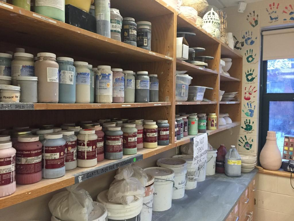 Different glazes line the shelf of the Ceramics room. Photo by Casey Palmer.