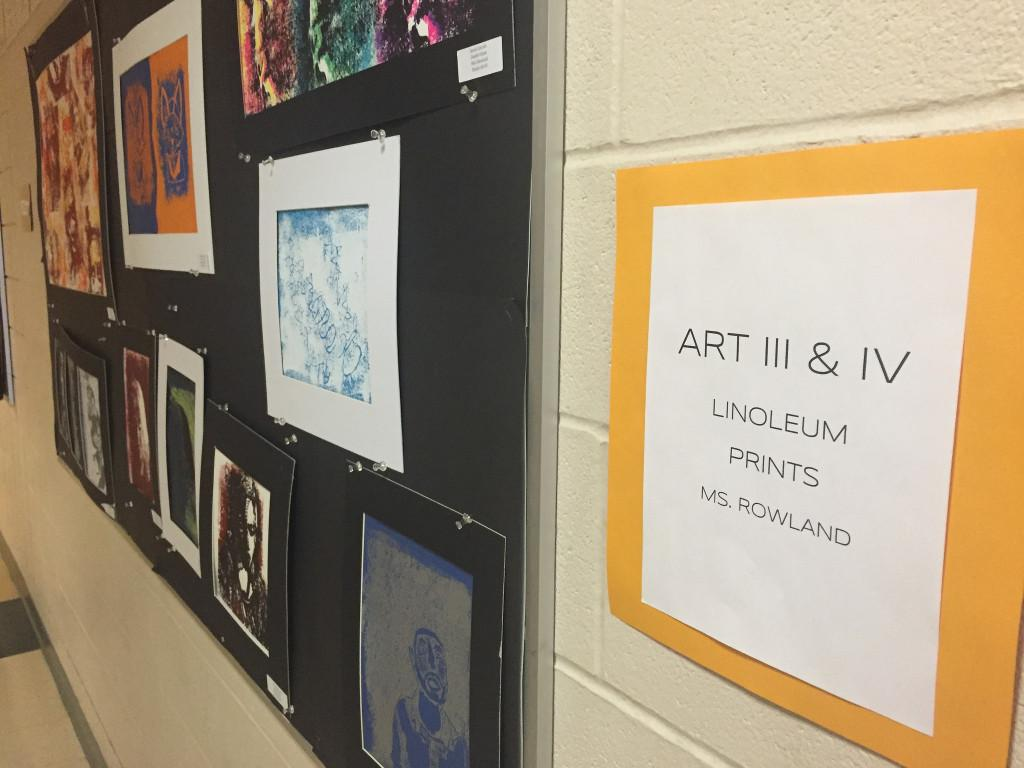 Art made by Hopkinton High School Students hangs on the display board outside of the art room. Photo by Allison McNulty.