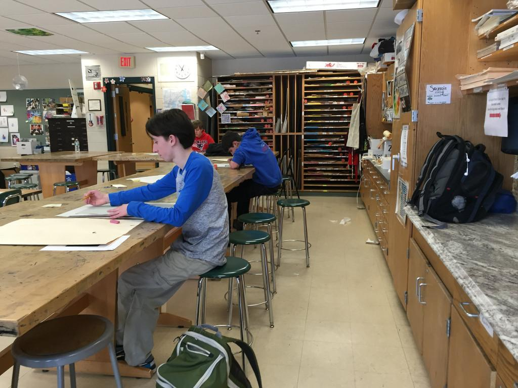 Freshman students work on their self portrait projects in Studio Art 1. Photo by Emma Zack.