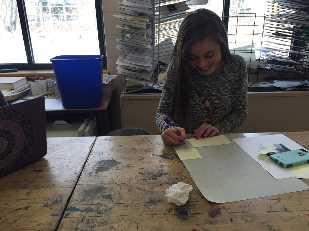 Freshman art student, Ciara Johnson, works on her self portrait in Studio Art 1. Photo by Casey Palmer.