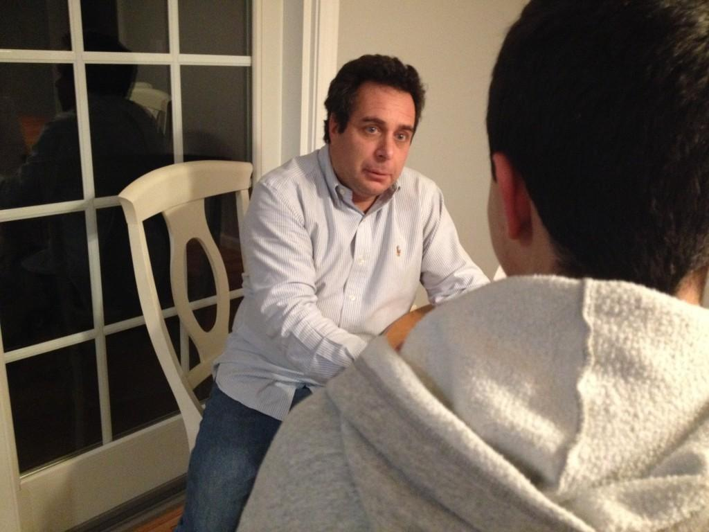 Some students study for finals by having others quiz them on material. Here, Ben Leibowitz, freshman, is quizzed by his father, Ross Leibowitz.