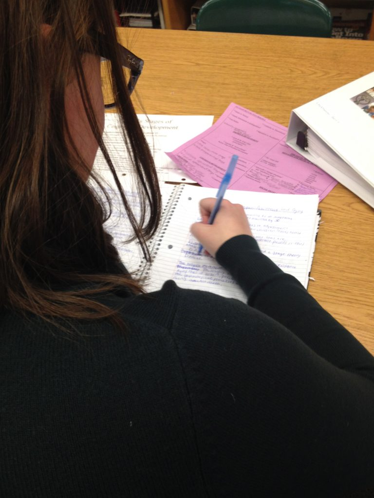 Chryssanthi Barris, senior, studies for her AP Psychology final by rewriting her notes.