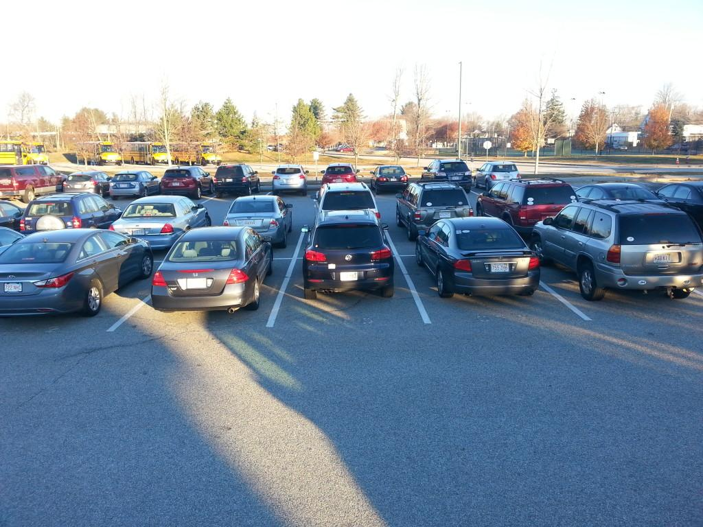 "Cars fill ""F"" lot now that students have arrived at school."