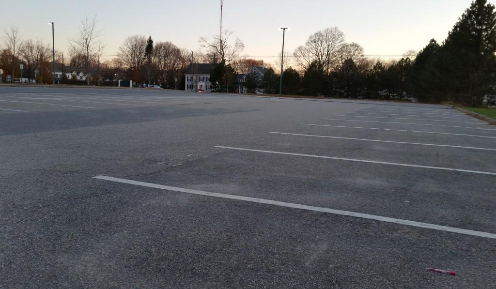 """The asphalt at """"F"""" lot breathes easy before the weight of more than 50 cars bears down on it."""