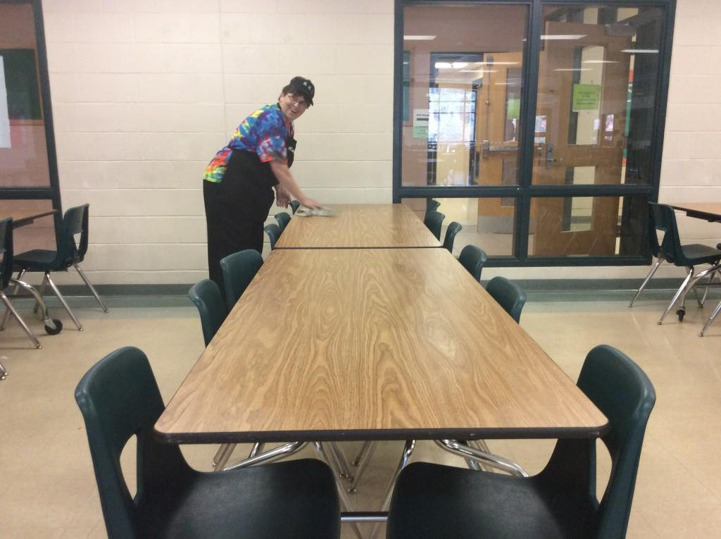 Kathy Bieri cleans a table in between lunches.