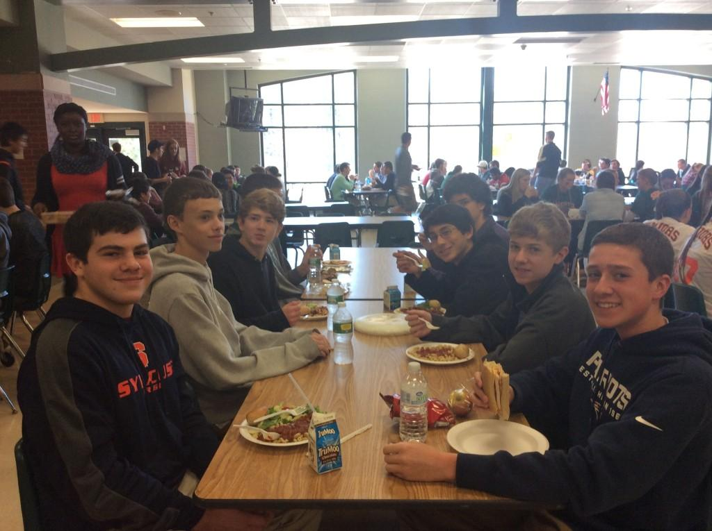 Sophomore students enjoying their lunch in the cafeteria.