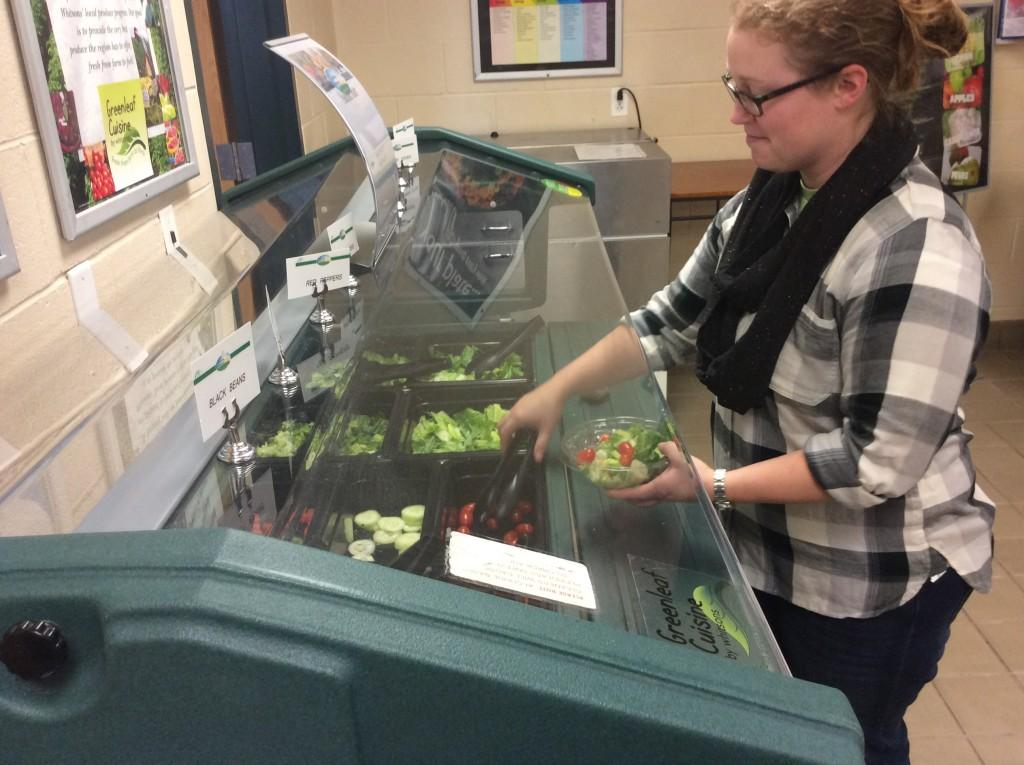 History teacher Shannon Allberry chooses a healthy lunch option offered in the cafeteria, salad from the salad bar.