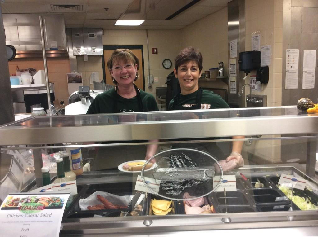 Katy D'Aesio and Cathy McLaughlin make customized paninis, wraps, and sandwiches during the busy lunch rush