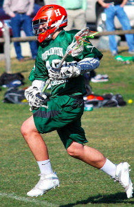 Jack Guelfi gives it his all during Hopkinton Varsity Lacrosse tryouts at Fruit Street Field in Hopkinton, MA on Wednesday, March 23. Photo by Nick Ludorf