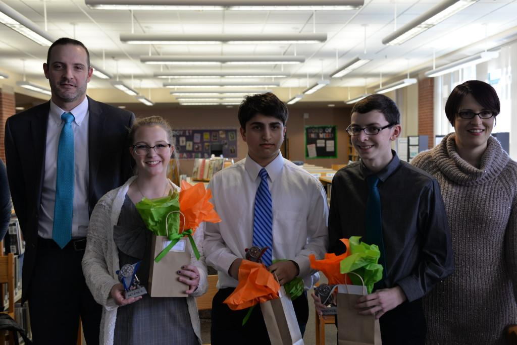 Principal Evan Bishop (left) and science fair advisor Devon Grilly (right) pose with the winners of the 2016 HHS Science Fair, sophomores Freya Proudman and Himanshu Minocha and junior Brian Best. Photo courtesy of Fred Haas.