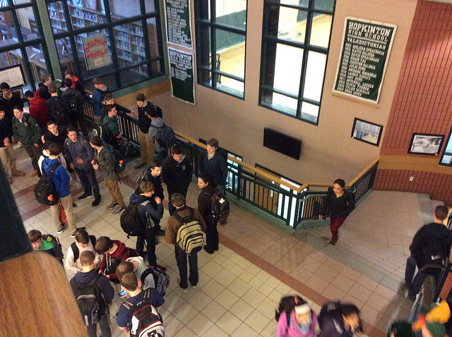 Students gather in the atrium in anticipation of the bell to ring for first period. Photo by Sarah Fromer.