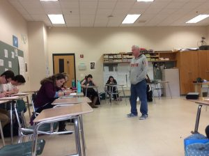 AP Language and Composition teacher, Michael Franchock, reviews a multiple choice activity with his class of 27 juniors.