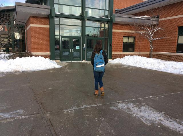 A student arrives late to school on a cold snowy day. Photo by Josh Normandeau.