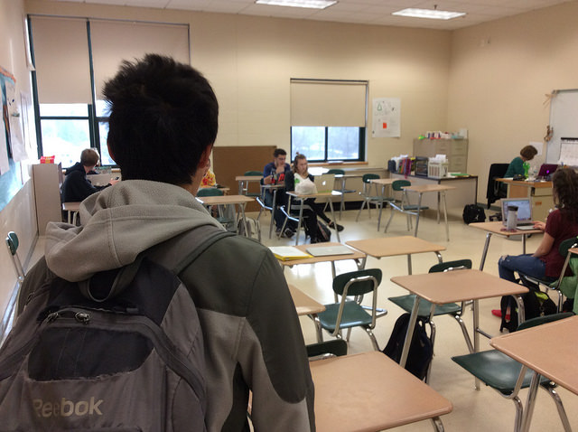 Brian Gao, a senior, entering first period Spanish class late. Photo by Josh Normandeau.